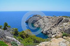 A rocky coastline with a small bay on the island of Mallorca