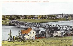 "Moncton, NB Remember the old Gunningsville Bridge between Moncton & Riverview ? I remember biking across on the wooden ""sidewalk"", and being scared to death I""d fall through!"
