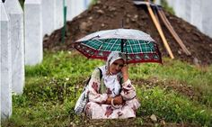 Under the command of Ratko Mladic and Radovan Karadzic, Bosnia Serb forces 'virtually eliminated the Muslim population of Srebrenica'.  In a five day campaign at the UN designated safe area in Eastern Bosnia and Herzegovina, which led to around 8,000 Bosniak Muslim men and boys being murdered by Serb forces. Photo: A woman mourns during last year's funeral of 534 newly identified victims of the 1995 Srebrenica massacre. Photograph: Damir Sagolj/Reuters