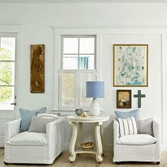 Give a small seating group flair by adding pops of art and wall hangings.