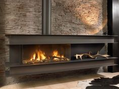 A bold and beautiful wall hung, modern gas fire, the Seno with its steel construction fixed to the wall, seemingly floats elegantly above the floor. Home Fireplace, Modern Fireplace, Living Room With Fireplace, Fireplace Design, Cosy Interior, Interior Design Living Room, Living Room Designs, Midland Hotel, Wall Fires