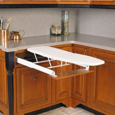 The Built-In Ironing Boards save space in any home because they fit right in a cabinet drawer. The supports extend out allowing you to iron heavy clothes.