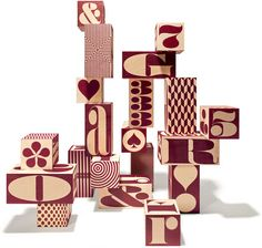 Distinctive House Industries typographic elements artfully squeezed, stretched and cubed into Uncle Goose's handmade hexahedrons then peppered with patterns provide aesthetes of all ages alphanumerosymbolic enlightenment.