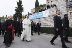 Pope Francis smiles as he arrives at sports camp of Serafico Institute in Assisi