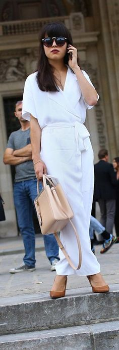 White jumpsuit and beige Fendi bag