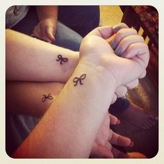 "Friendship tattoo representing being ""tied"" together. Cute idea... I'm not saying I like this tat or placement, but would y'all get something small and tiny like this with me? I think it'd be awesome to get matching tattoos with my two favorite people!"