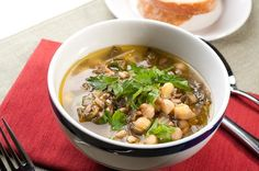 Vegetarian recipe for a hearty and warming soup made with farro, chickpeas and winter greens. Also vegan, kosher and gluten-free.