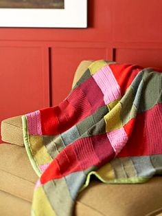 Recycle Sweaters: Make a Throw or Pillow... pretty color scheme-- rows of greens, and rows of reds