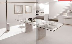 pristine white dining room with simple glass dining table