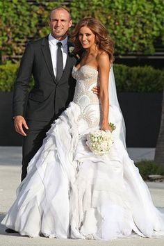 Heavily beaded #weddingdresses can be made affordable by our dress design firm.  Adding beading to any of the #dresses we make is not an issue. Custom designs (or even #replicas) can be made however you want.  Get pricing on wedding gowns with dense embellishments by contacting us directly at www.dariuscordell.com