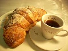 Damien spoils Nikki with a breakfast in bed on her first day of her new job of delicious coffee and croissants ~ The Stark Trilogy by J. Kenner
