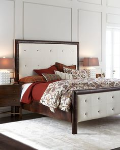 """<ul> <li>EXCLUSIVELY OURS .</li> <li>Maple frame.</li> <li>Upholstered squares with pulled buttons on footboard and headboard.</li> <li>Polyester and waxed leather with protective coat.</li> <li>Assembly required.</li> <li>81.5""""W x 83.5""""L x 72.5""""T.</li> <li>Made in the USA.</li> </ul>"""