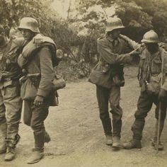 Imperial German soldiers helping wounded French soldiers. World War One.