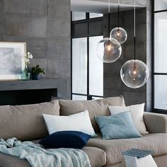 Stunningly simple, domed glass shades bring a light, open feel to winter style. #wintercollection #black #homeinspo #ontrend #lighting