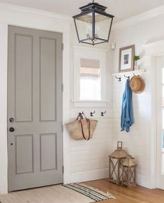 Painting an interior door may seem minor but it can change the entire look of a room. We love what @SawNailAndPaint has done with her front door. Colors featured: @BenjaminMoore Rockport Gray (door) and Dove Wing (walls).    #janovic #janovicnyc #thecolorauthority #paint #benjaminmoore #metropolitan #window #windowdesign #windowdecor #windowcoverings #upholstery #windows #homesofinstagram #apartmentdecor #apartmentliving #interiordesign #interior #interiorsofinstagram #benjaminmoore #decor Grey Interior Doors, Interior Door Colors, Painted Interior Doors, Door Paint Colors, Grey Doors, Painted Doors, Interior Design, Classic White Kitchen, Woven Shades