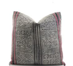 This pillow cover is sewn from 2 pieces of a gray, handwoven, Hmong textile featuring red embroidered stripes. Please note that the pillow cover you