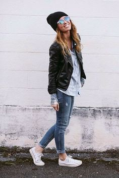 Denim light blue check shirt with black shining leather jacket and casual stylish dark blue grey jeans and white shoes and black warm cap th...