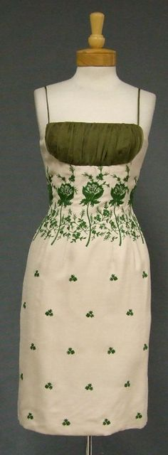 A FABULOUS 1950's wiggle dress in a light beige linen textured rayon with green floral embroidery, with shelf bust and matching organdy straps. I LOVE a good shelf bust. I really do.