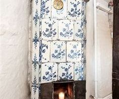Rustic blue & white tiled Swedish stove