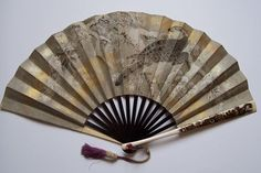 Japanese man's fan, paper leaf, wood and ivory sticks, makie (lacquer) work, coral ring, early Meiji or Edo period.