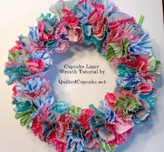 How to make a wreath with cupcake liners. Easy Cupcake Liner Wreath Tutorial by QuiltedCupcake