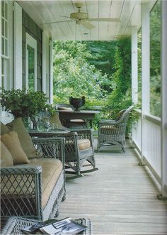 Porch wicker painted a pretty blue-gray with dining at one end - Nancy Braithwaite
