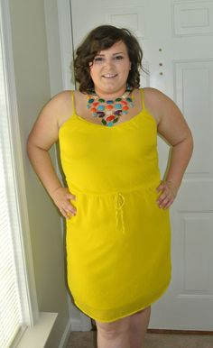 I love this yellow dress! The statement necklace completes the outfit perfectly! A great blog! A must Pin!