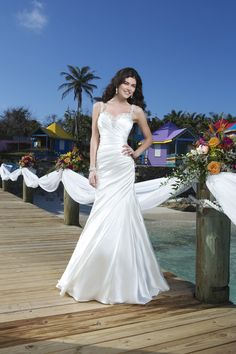 """Spring 2014 Style #3788 """"Dazzling Paradise - Charmeuse asymmetric pleated mermaid gown features a beaded sweetheart tank neckline and deep V-back. Style is finished with charmeuse buttons and a chapel length train."""""""