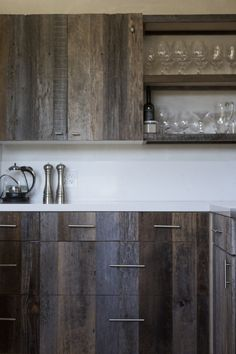 Michael-Roche-Napa-Valley-Kitchen-wood-cupboards-ikea cabinets refaced with barnwood Remodelista
