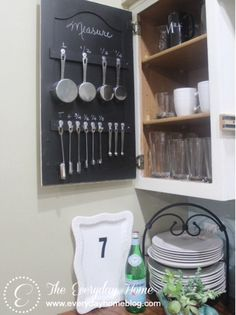 Find storage in unexpected places. This cupboard door is perfect for added storage and keeping kitchen tools easily accessible. The chalkboard backing is great for keeping those small utensils organized.