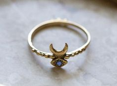 Hand Carved Inanna Ring Cast in 14k Gold with Blue Sapphire by ButchandMiggs on Etsy