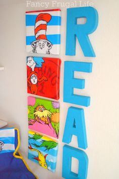 Dr. Seuss canvas collage made from dollar bin bags.  Under the Stairs Closet turned Kids Book Nook |