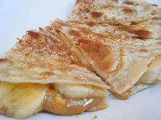 """HEALTHY PEANUT BUTTER BANANA QUESADILLA!"" EASY, so yummy, a great ANYTIME snack or breakfast, fuel for workouts, and kid friendly! Make sure you serve warm so it is EXTRA OOEY GOOEY!"