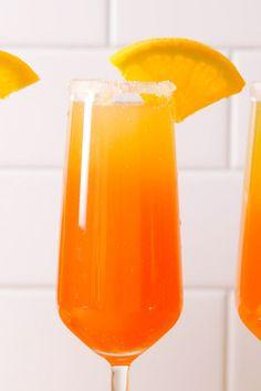 Tequila Sunrise Mimosas:      Orange wedges, for rim and garnish;      Sugar, for rimming glass;     2 oz. tequila;     1 bottle champagne;     1/2 c. orange juice;     Few splashes grenadine.