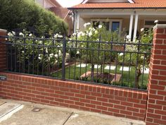 Red brick pillars with charcoal grey ironor painted