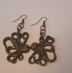 Octopus earrings,Octopus, Ocean gift, Octopus jewelry, Ocean, Gifts for her, Tiki, Starfish,cephalopod Size is approx 2 1/2 inches These are a