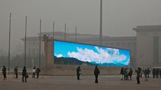 An LED screen displays blue sky in Tiananmen Square, Beijing. Picture: Feng Li / Getty Images