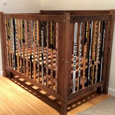 A crib i built out of hockey sticks and oak. Like each stick is over 100 bucks. Hoping they actually played hockey with the each one of them before they made them railing. Hockey Nursery, Hockey Bedroom, Hockey Baby, Nursery Room, Nursery Ideas, Nursery Themes, Baby Boy Room Decor, Baby Boy Rooms, Baby Boy Nurseries