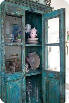 lovely old chipped cabinet for storing wares