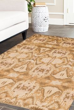 This Ikat rug gives the appearance of a toasted or burnt design. The pattern is broken up into 3 sections, two thin sections on the top and bottom and one large section in the middle. #goldrugs #buygoldrugs #buygoldrugsonline #rugknots Oriental Design, Gold Rugs, Ivory Rugs, Floor Decor, Puzzle Pieces, Rug Making, Rugs Online, Neutral Colors, Ikat