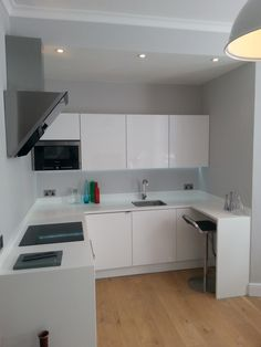 Small modern white kitchen, with breakfast bar. Made great use of the space. Kitchen completed by our member Roxwell Contracting - see more of their great work here https://www.experttrades.com/trade/roxwell-contracting/gallery  #kitchen #smallkitchen #whitekitchen #modernkitchen #breakfastbar #inspiration #home #homedecor