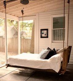 Hanging bed in coastal sunroom
