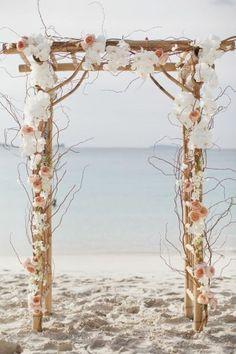 white flowers wedding arch for beach weddding