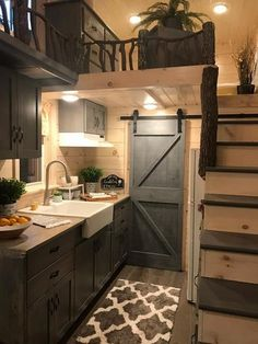 This is the Dandelion Tiny House on Wheels by Incredible Tiny Homes. It features a wood clad exterior siding, lots of windows, exterior storage, and it sits on a sturdy triple-axle trailer.… homes Dandelion Tiny House Built by Incredible Tiny Homes