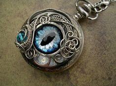 steampunk art -pendant with a realistic dragon eye