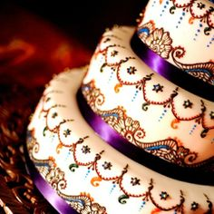 Beautifully detailed colorful Indian style wedding cake.