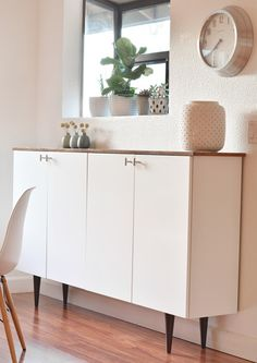 Ikea hack - this combines a stained plank with IKEA's Akurum upper cabinets and furniture legs from Etsy creating a sideboard with a very sleek and stylish look with a mid century vibe.