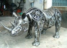 Rhino statue made from scrap metal art, Thailand—sustainable and beautiful!