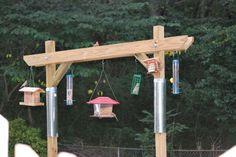 bird feeder station ideas Introducing an ingenious squirrel-proof bird feeder. More squirrelproofbirdfeeders Bird Feeder Stands, Bird Feeder Hangers, Bird Feeder Poles, Diy Bird Feeder, Squirrel Proof Bird Feeders, Bird Feeding Station, Bird House Kits, Bird Aviary, How To Attract Birds