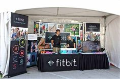 Fitbit trade show booth attracts a fit crowd.